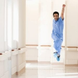 Physician dancing down hall